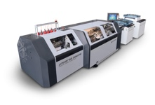 Universe Sewing Web-fed, automatic book folding and sewing line for the production of books directly from the roll.